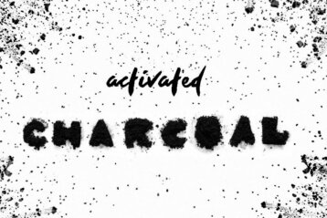 Activated Charcoal Powder Splash Background